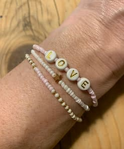 love stretch bracelets in pink white and gold