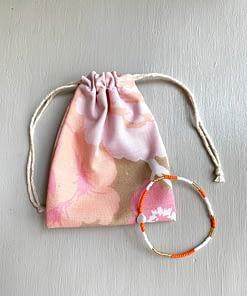mother of pearl heart bracelet in neon orange