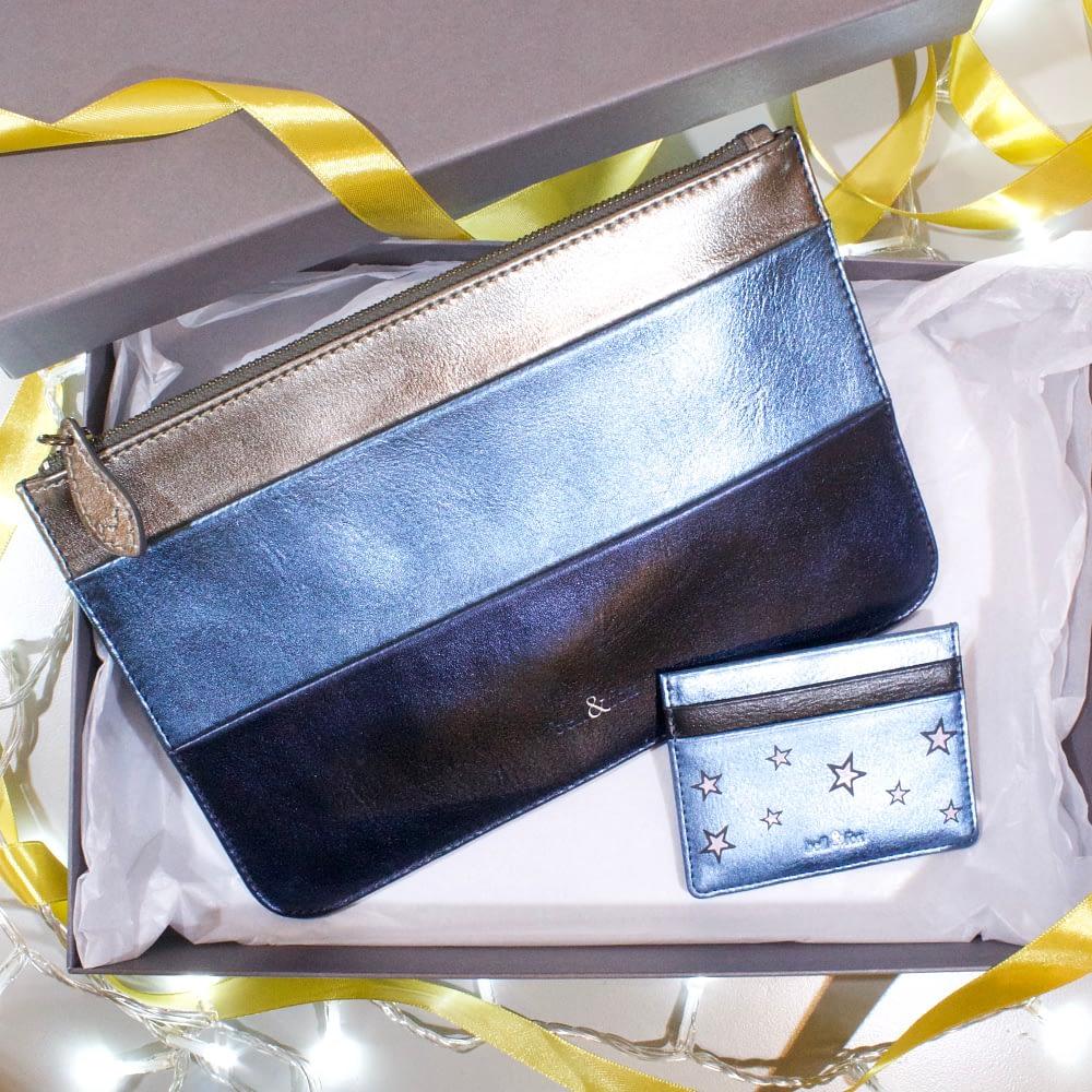 metallic stripe clutch and card holder in metallic blue leather