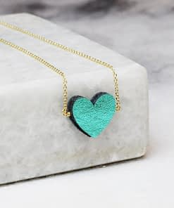 green leather heart necklace on gold chain